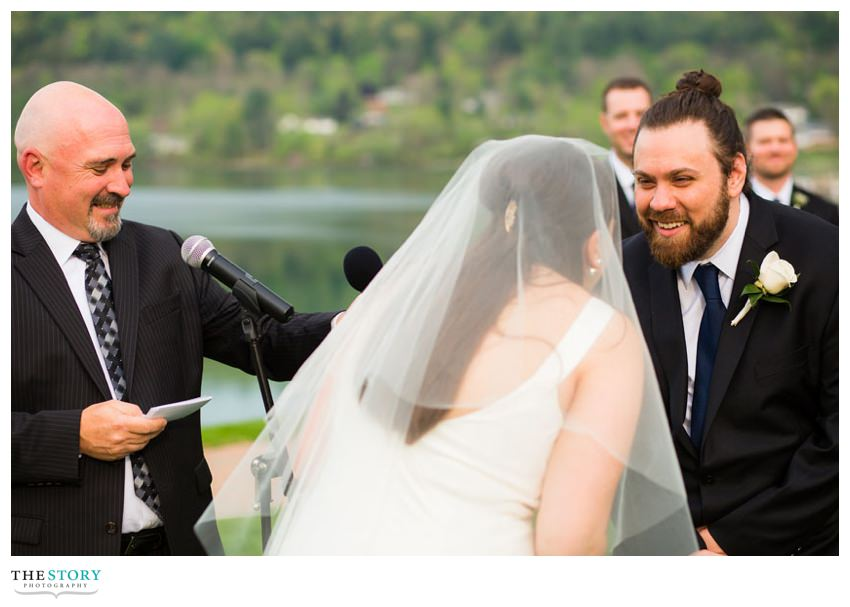 bride and goom exchange vows at lakeside wedding in Cooperstown
